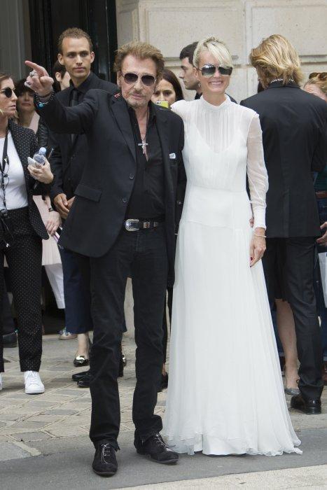 Johnny Hallyday et Laeticia au défilé Haute Couture de Christian Dior, à Paris, le 4 juillet 2016.