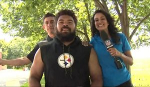 Aditi and Andrew need chairs to reach eye level of Steelers players