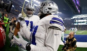 Zeke makes a donation in Salvation Army kettle after TD run