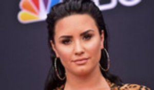 Demi Lovato Returns to Instagram, Shows She Knocked Out MMA Trainer's Tooth | Billboard News