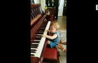 The musical talent of a kid in front of a piano