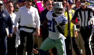 Ezekiel Elliott drops Earl Thomas with strong stiff arm