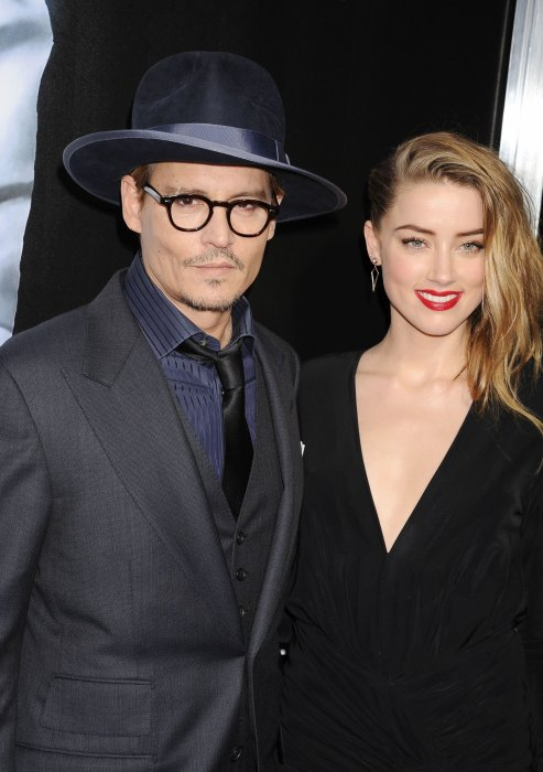 "Johnny Depp et Amber Heard assistent à la première du film ""3 Days to Kill"" à Hollywood, le 12 février 2014."
